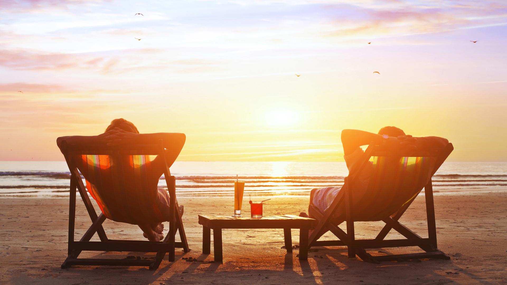 happy couple enjoy luxury sunset on the beach during summer vaca